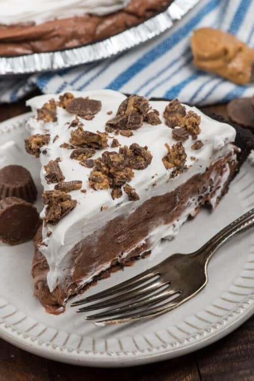 Slice of Peanut Butter Cup Pie on a white plate with a fork