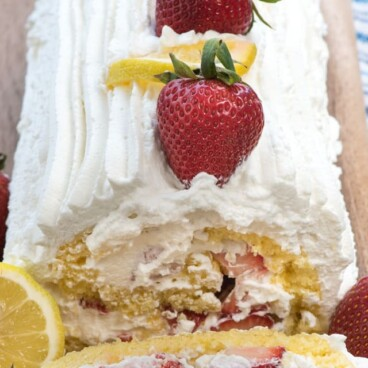 Lemon Strawberry Shortcake Cake Roll has a lemon sponge cake filled with whipped cream and strawberries for the perfect strawberry shortcake!