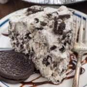 slice of oreo fluff pie on white plate
