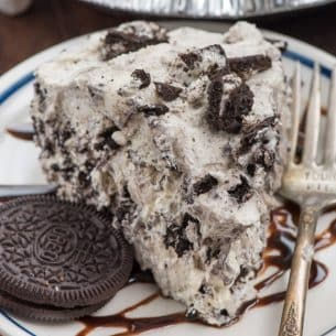 slice of oreo fluff pie on white plate