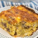 slice of sausage egg casserole on white plate