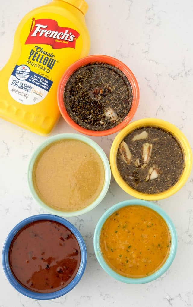 overhead shot of 5 sauces in colorful bowls