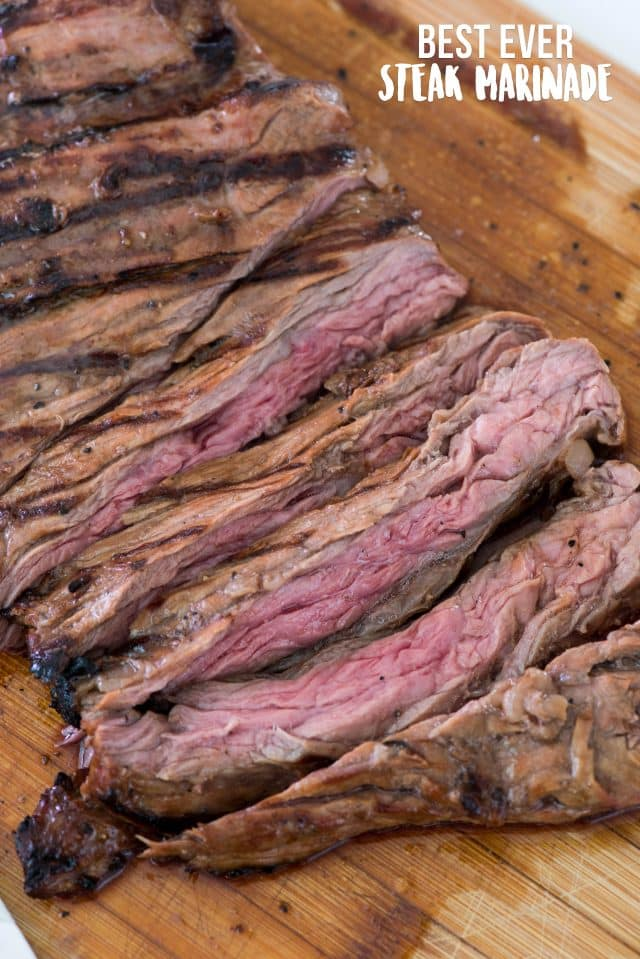 grilled steak sliced on cutting board