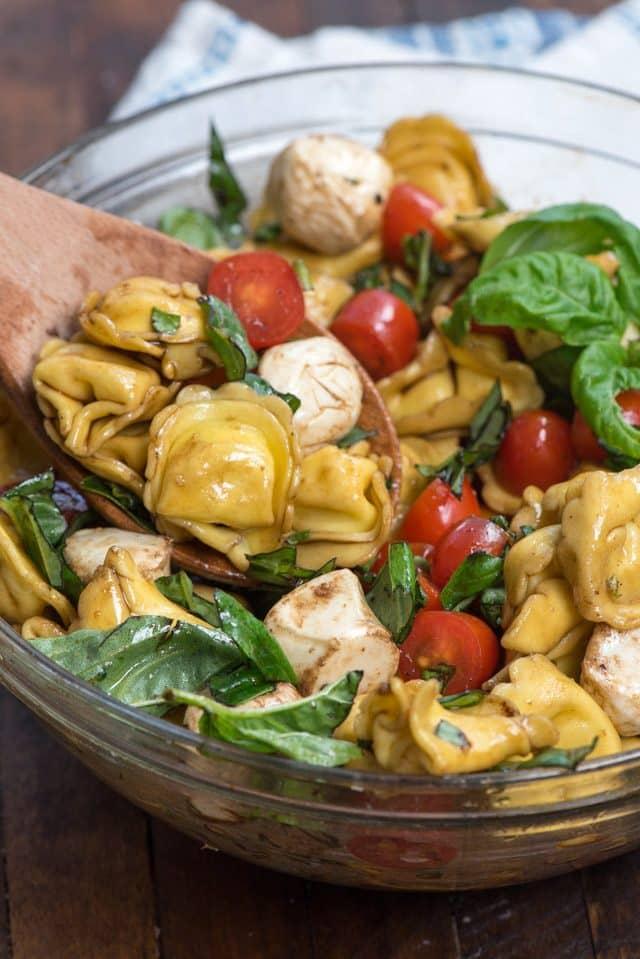overhead shot of tortellini caprese pasta salad