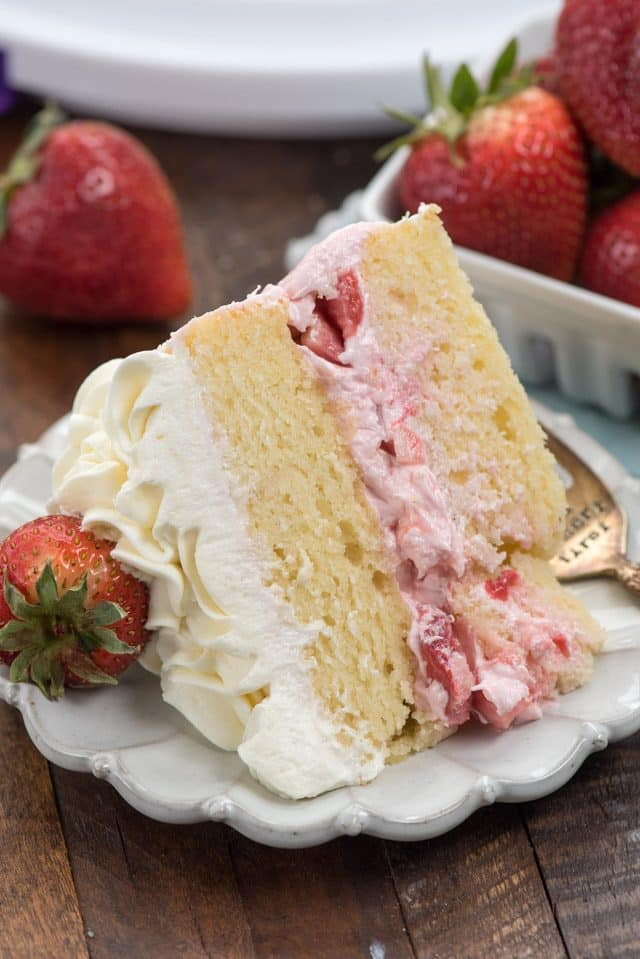 slice of strawberry shortcake layer cake on plate