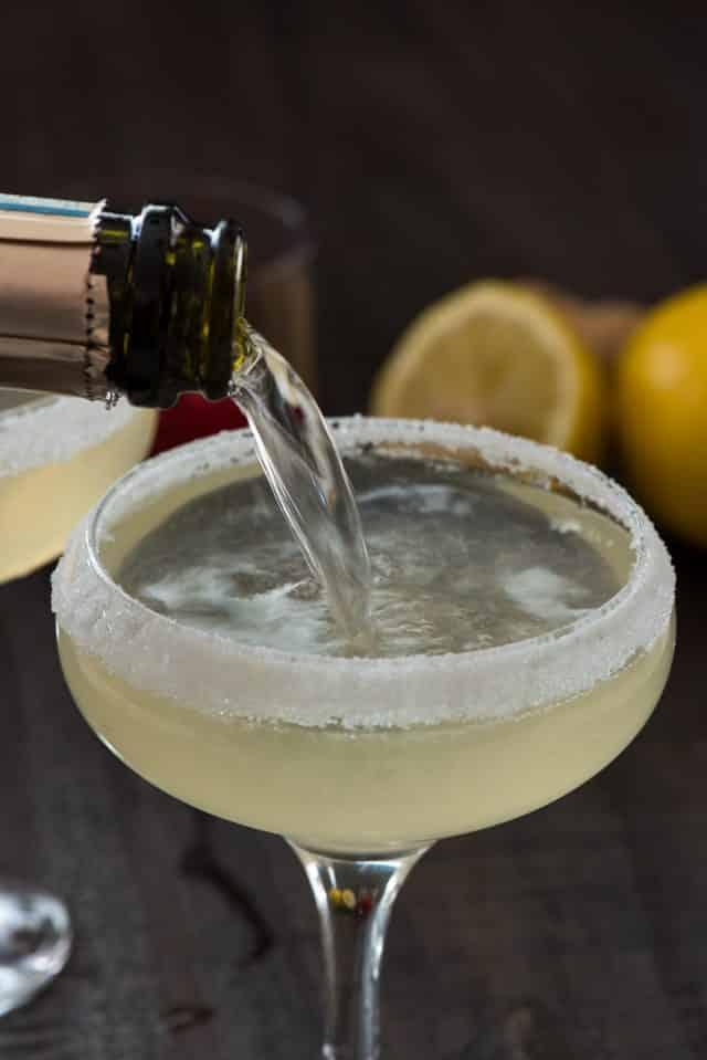 pouring champagne into martini glass
