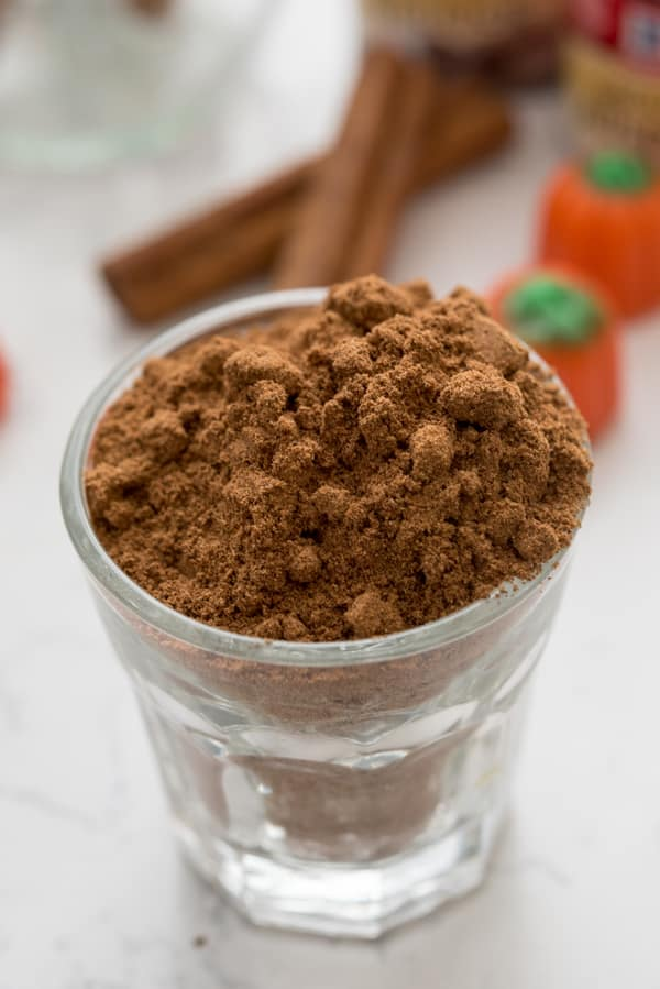 Glass full of Spices on a counter