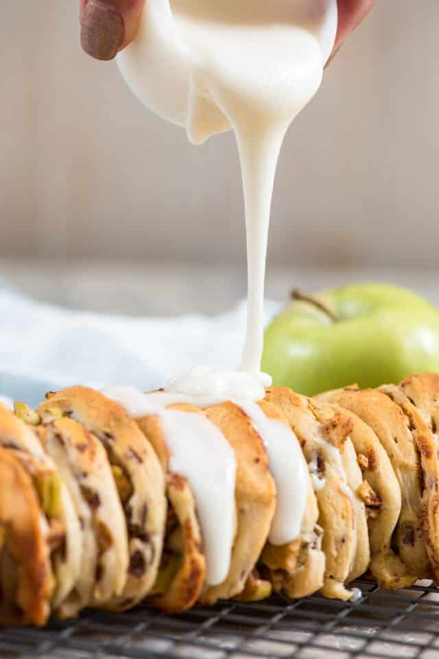pouring frosting on apple fritter bread