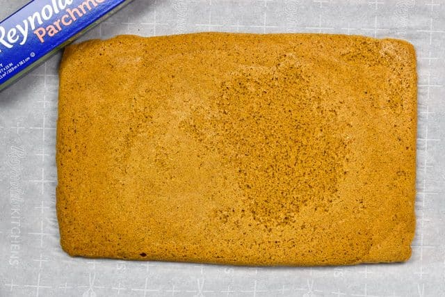 pumpkin roll cake on parchment paper