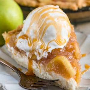 slice of cheesecake apple pie on white plate