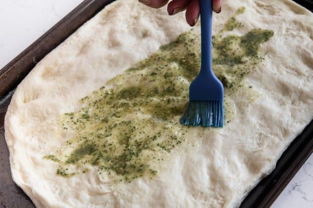 brushing dough with ranch mix