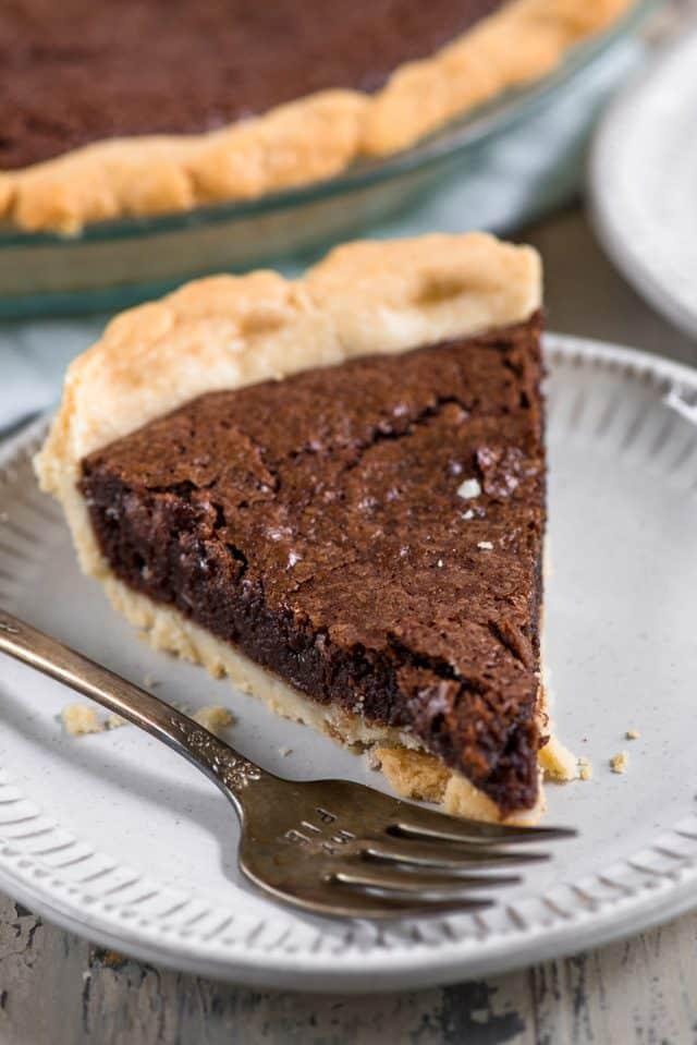 chocolate fudge pie slice on white plate