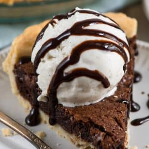 slice of chocolate fudge pie with ice cream