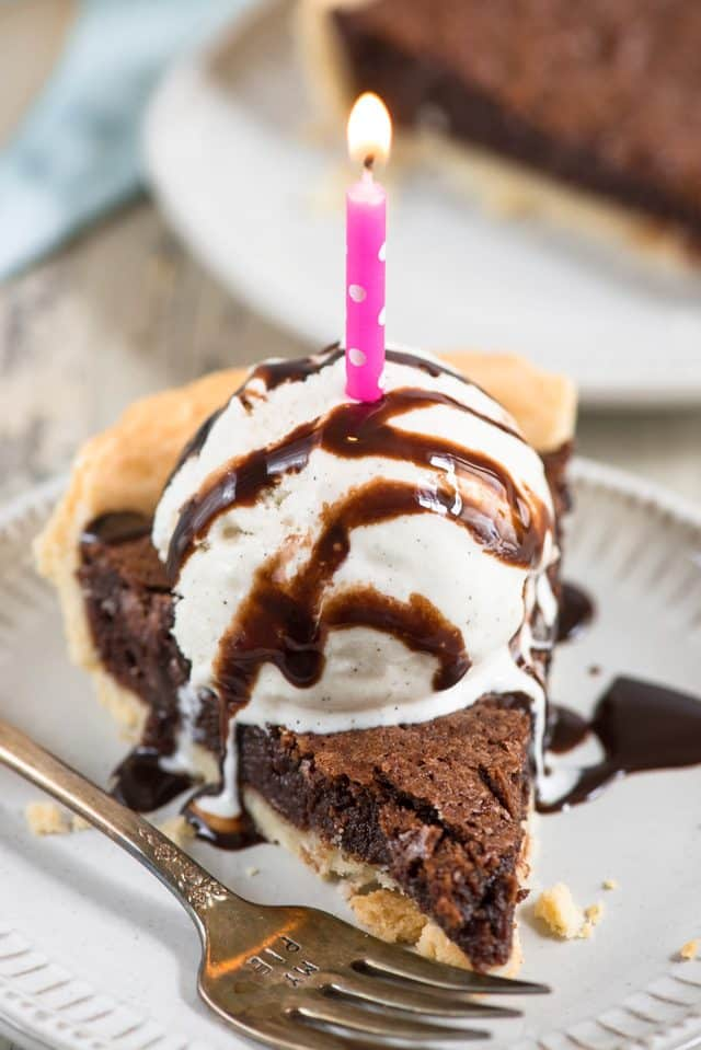 chocolate fudge pie with ice cream and candle