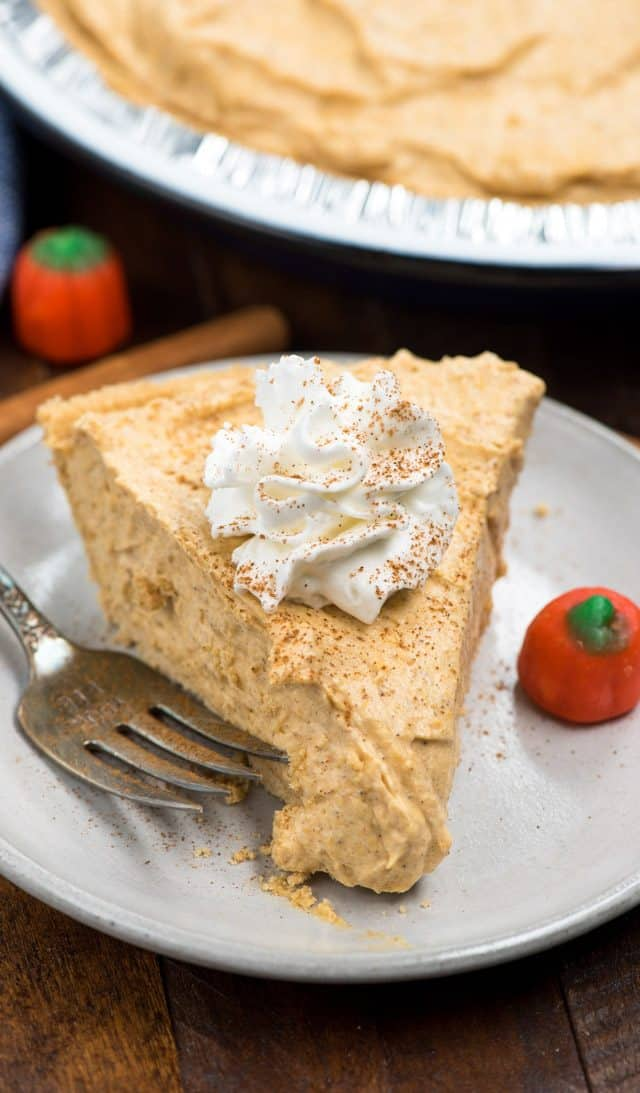 slice of no bake pumpkin pie on white plate