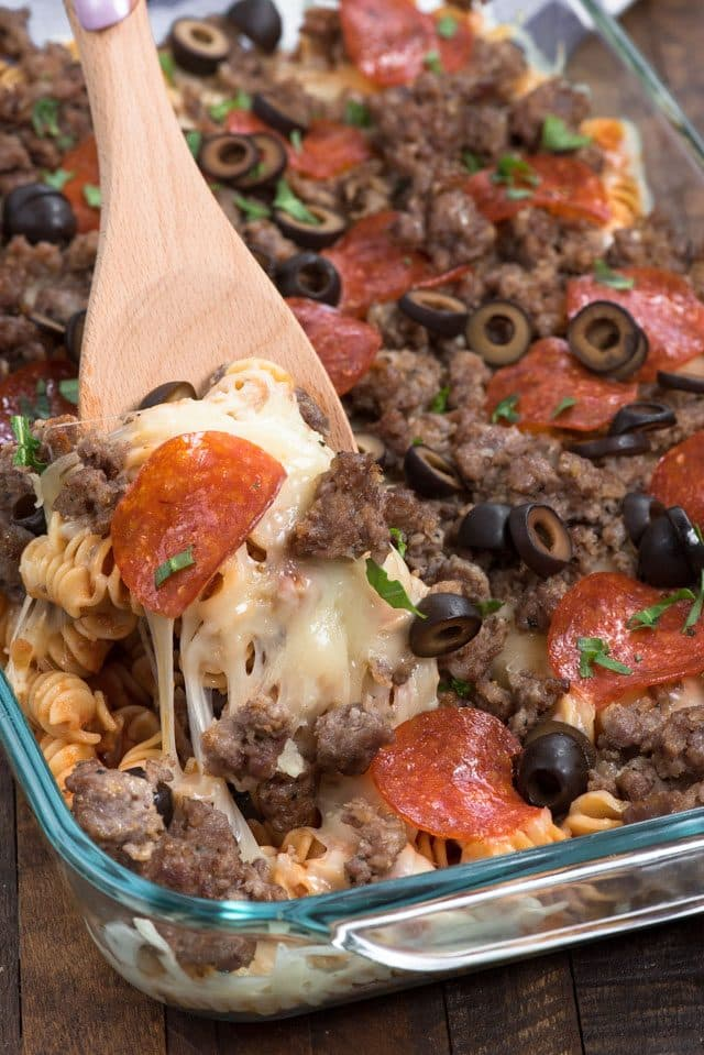 Pizza pasta casserole with wooden spoon