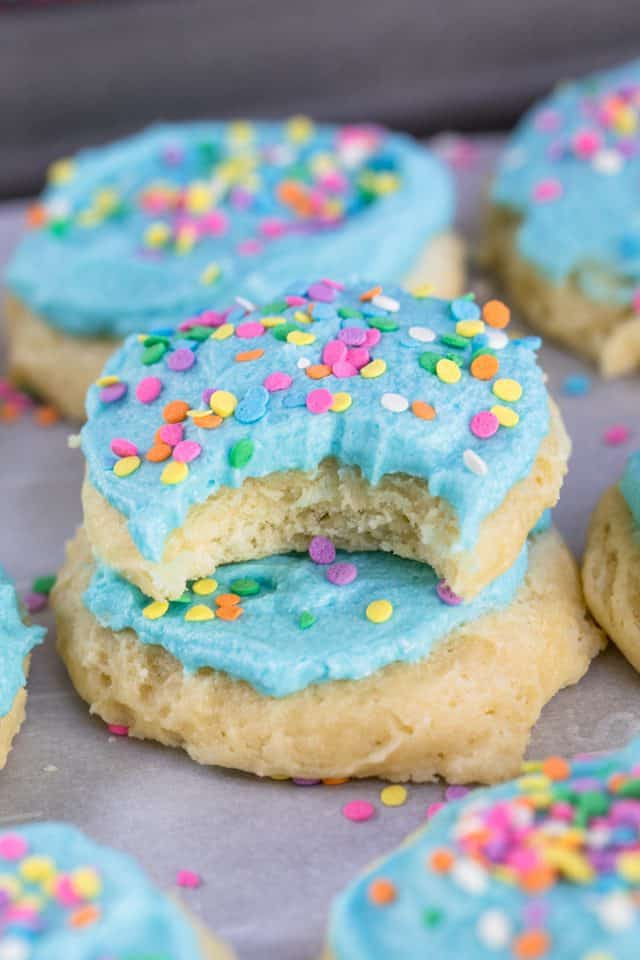 Stack of Lofthouse Sugar Cookies with a bite out of the top cookie