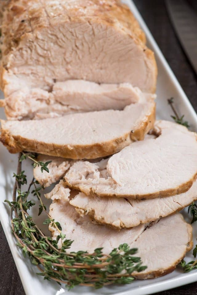 platter of sliced slow cooker turkey breast