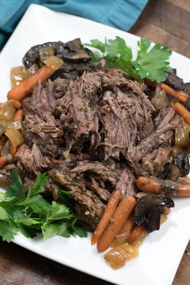 crockpot pot roast on white plate