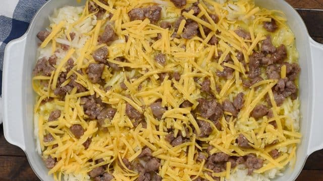 How to make Hashbrown Casserole with sausage, eggs, and cheese.