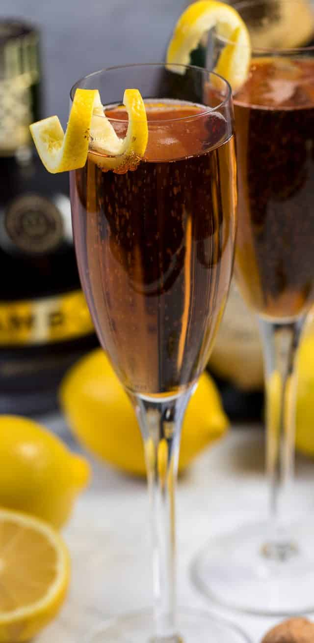 kir royale in glass with slice of lemon