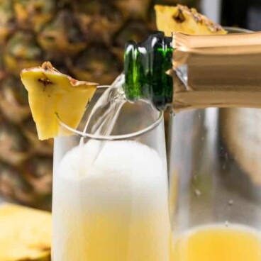 pouring champagne pineapple mimosa