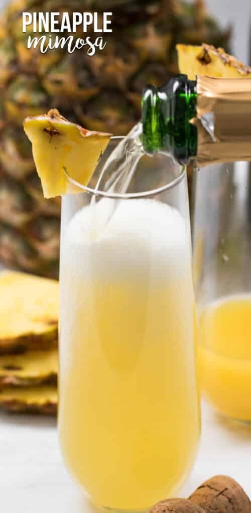 pouring champagne into pineapple mimosa