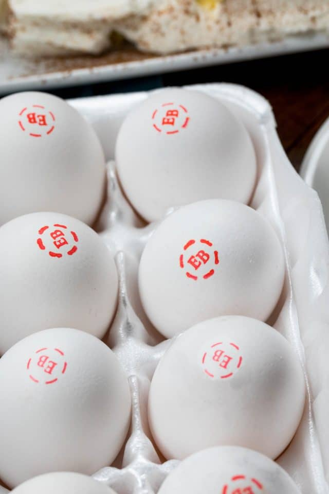 "a Carton of eggs stamped with ""EB"" on them"