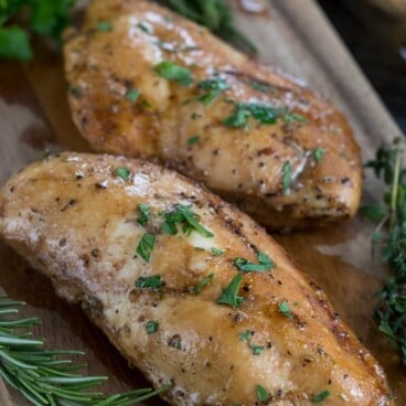 oven baked chicken on cutting board