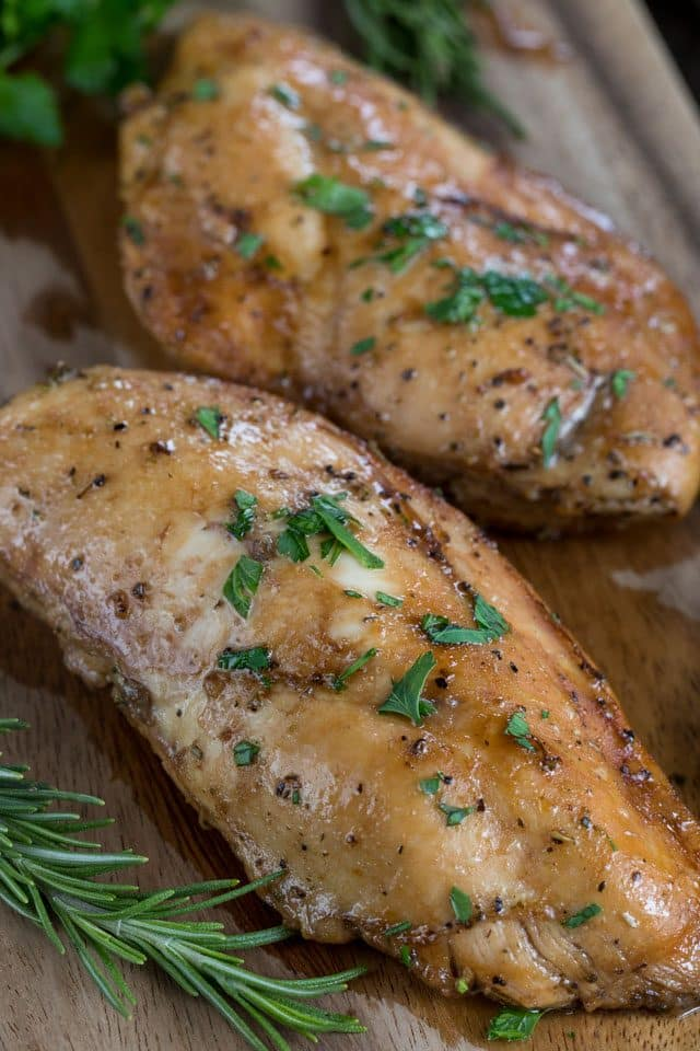 oven baked chicken on cutting board.