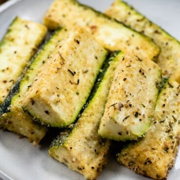 parmesan roasted zucchini on white plate