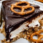 slice of chocolate covered pretzel no bake cheesecake