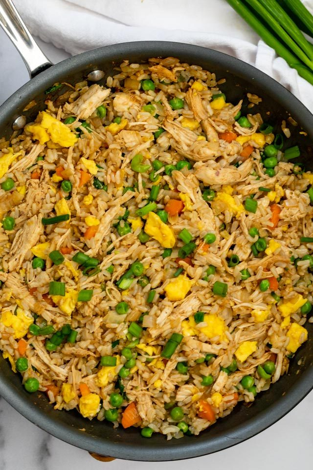 overhead shot of chicken fried rice in pan