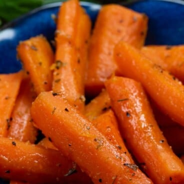 roasted carrots on blue plate