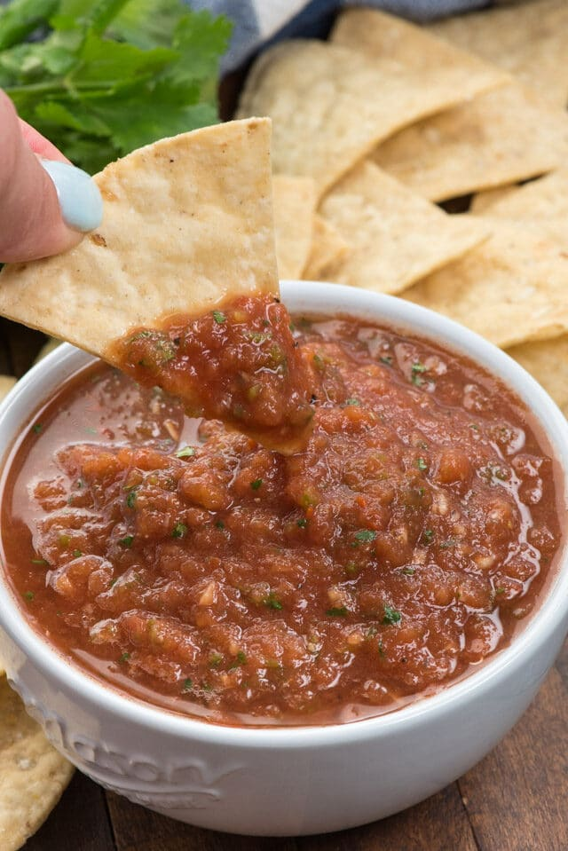 salsa in white bowl on chip