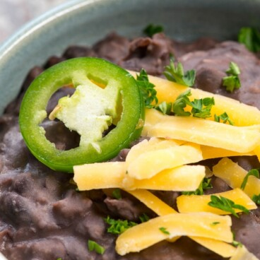 easy refried black beans in blue bowl