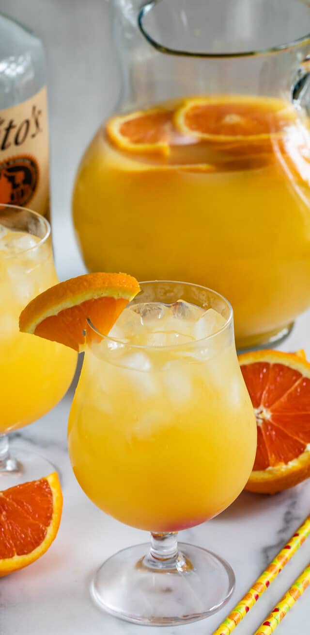 orange party punch in glass and pitcher