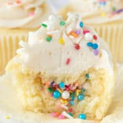 piñata cupcake with half missing and sprinkles