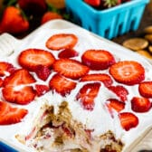 strawberry shortcake icebox cake in pan with slice missing