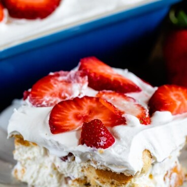 slice of strawberry shortcake icebox cake on plate