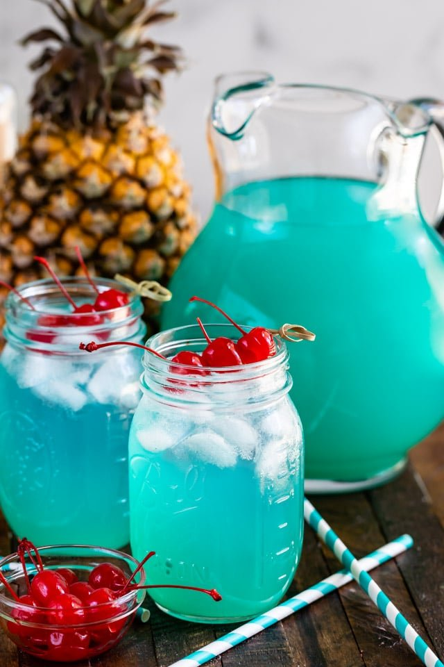 blue Hawaiian party punch in mason jar with pitcher