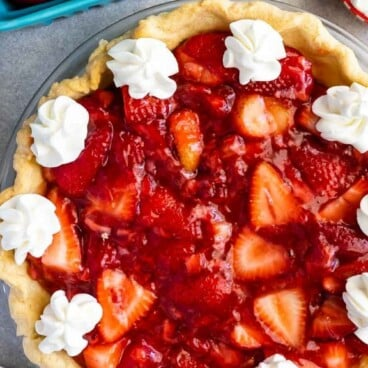 overhead photo of strawberry pie with whipped cream