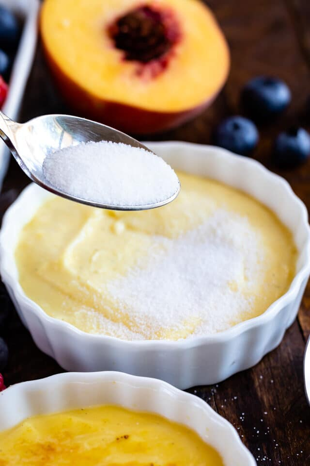 sprinkling sugar on creme brûlée