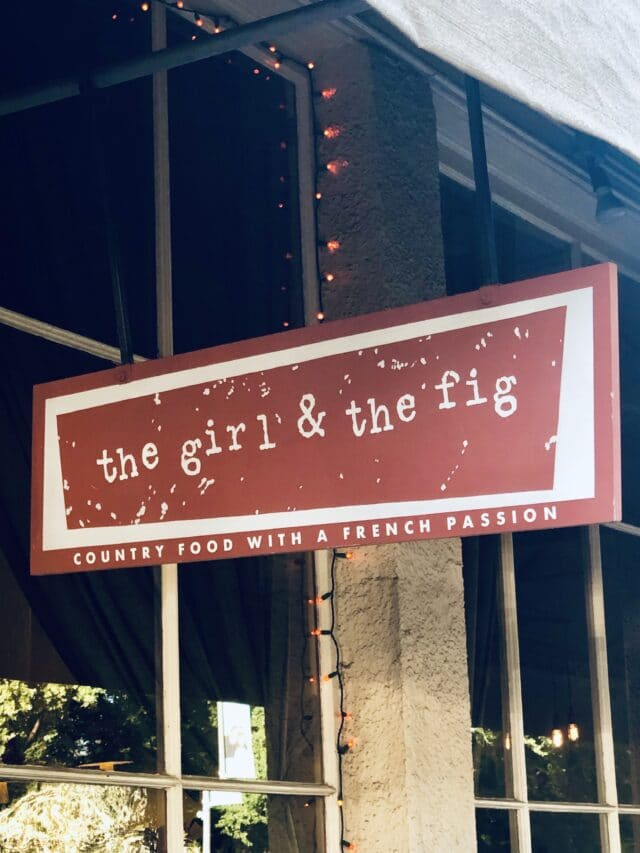 The girl and the fig sign