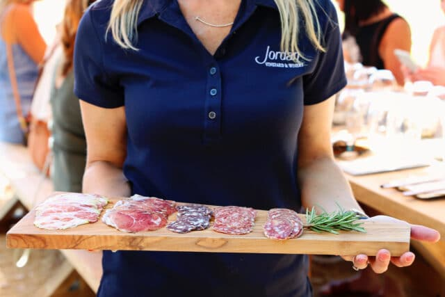 woman holding charcuterie tray