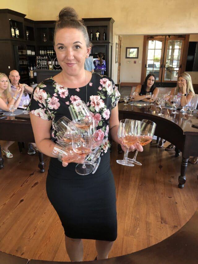 woman holding wine glasses