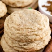 pumpkin spice snickerdoodles in a stack on cutting board