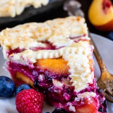 slice of peach blueberry pie on plate