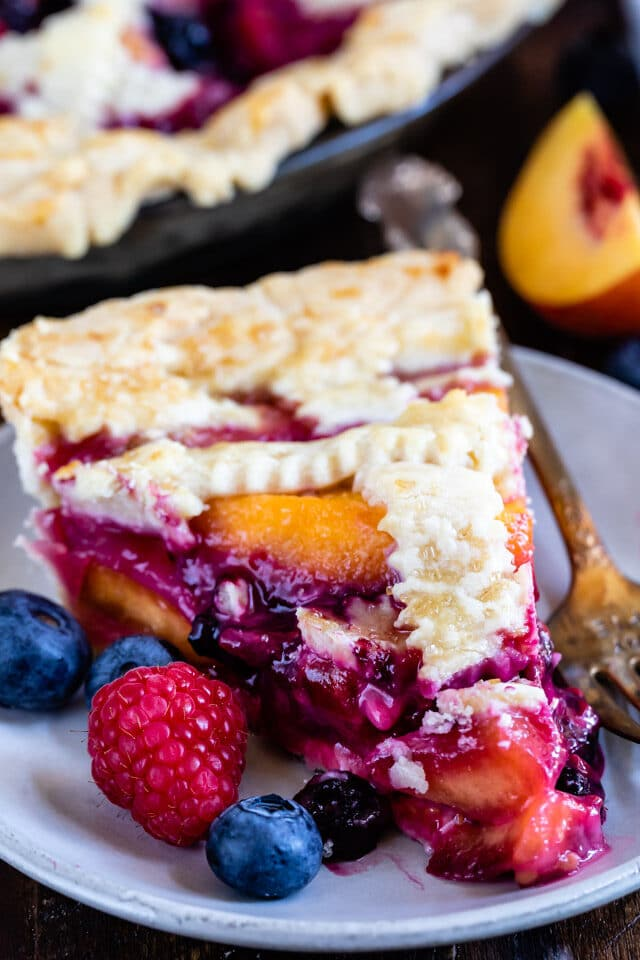 slice of peach blueberry pie on plate
