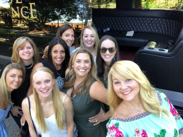 Picture of 9 women in front of a restaurant